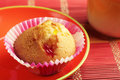 Tasty muffin in red plate on colorful bamboo napkin Royalty Free Stock Photo
