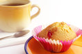 Tasty muffin and tea with jujube in yellow plate cup of Royalty Free Stock Photography