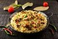 Tasty Mutton biriyani in cast iron cookware Royalty Free Stock Photo