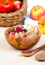 Tasty oatmeal with raspberries and apple in the wooden bowl Royalty Free Stock Photos
