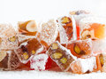 Tasty oriental sweets turkish delight lokum classic dessert sweet with powdered sugar Stock Photos