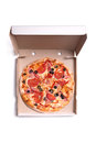 Tasty pizza with ham and tomatoes in box isolated on white background Stock Photo