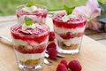 Tasty raspberry cheesecake in glass fresh summer dessert Stock Photography