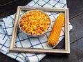 Tasty ripe corn kernels in a bowl. Royalty Free Stock Photo