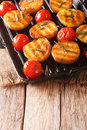 Tasty roasted potatoes and tomatoes with rosemary close up on a
