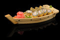 Tasty rolls in the boat hot small wooden Royalty Free Stock Photo