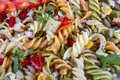 Tasty salad from pasta different colours Stock Photo