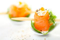 Tasty salmon rolls on white background Royalty Free Stock Photography