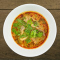 The tasty spicy pork tom yum soup hot and sour soup in white ceramic bowl homemade thai food Royalty Free Stock Image