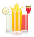 Tasty summer fruit drinks in glass with splash isolated on a white background Stock Images