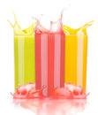 Tasty summer fruit drinks in glass with splash isolated on a white background Stock Image