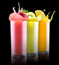 Tasty summer fruits with juice in glass set of and tube Royalty Free Stock Photos
