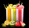 Tasty summer fruits with juice in glass set of and tube Royalty Free Stock Photography
