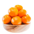 Tasty sweet tangerine orange mandarin fruit in wooden bowl mandarine isolated on white background Royalty Free Stock Images