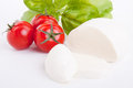 Tasty tomatoe mozzarella salad with basil on white Stock Images