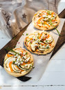 Tasty vegetarian pizzas with pepper and eggplant trio of mini sweet bell cheese herbs granished fresh chives for a delicious Stock Images