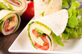 Tasty wrap selective focus on the front tortilla Stock Images