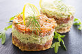 Tatar with salmon and avocado as closeup on a black slate Royalty Free Stock Image