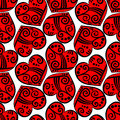 Tatoo hearts seamless background patterned red with tribal effects tile Stock Photo