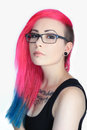 Tattoo girl with colorful hair and glasses pink blue lips pierce on a white background Stock Images