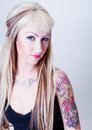 Tattoo Girl With Coy Look Royalty Free Stock Photo