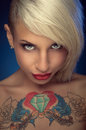 Tattoo woman beautiful blond with a on his chest Royalty Free Stock Image