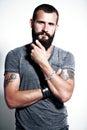 Tattooed bearded man wearing gray t shirt Stock Photography
