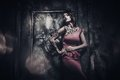Tattooed beautiful woman in old spooky interior Stock Image