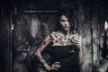 Tattooed beautiful woman in old spooky interior Royalty Free Stock Photo