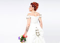 Tattooed bride seen from the back in full body posing in studio and looking away Royalty Free Stock Photography