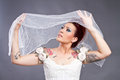 Tattooed bride with veil over her head Royalty Free Stock Photo