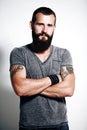 Tattooed brutal man bearded wearing gray t shirt Stock Photos