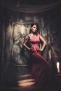 Tattooed woman in old interior beautiful spooky Stock Photos