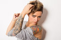 Tattooed woman studio shot of a young Stock Photos