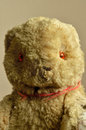 A tatty vintage teddy bear an old battered much loved Royalty Free Stock Images