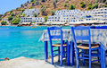 Tavern greek on near the sea with blue chairs Stock Photography
