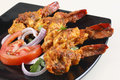Tawa prawn goan dish made of prawns from india spicy are in which are skewered and cooked on Stock Images