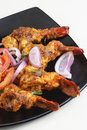 Tawa prawn goan dish made of prawns from india spicy are in which are skewered and cooked on Royalty Free Stock Photo
