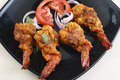 Tawa prawn goan dish made of prawns from india spicy are in which are skewered and cooked on Stock Photos