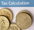 Tax calculation a heap of british pound coins showing the welsh leek and the coat of arms of the uk on a british office form Stock Photography