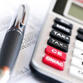 Tax calculator and pen Royalty Free Stock Image