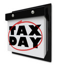 Tax Day - Words Circled on Wall Calendar Royalty Free Stock Images