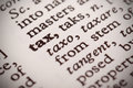 Tax defined the word in a dictionary Stock Photography