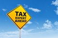 Tax expert ahead concept with a road sign under blue sky Stock Photos