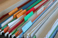 Tax files the inside of a file cabinet drawer showing colored hanging full of related paperwork and documents Royalty Free Stock Image