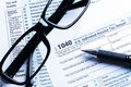 Tax form financial concept business with a pair of black glasses and a pen aside Stock Images