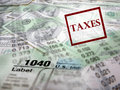 Tax forms on top of money detail closeup current and pencil Royalty Free Stock Image