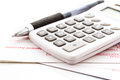Tax return calculating numbers for income with pen and calculato Stock Photo