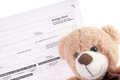 Tax return teddy and german with the german words conditioning child Royalty Free Stock Photos