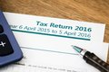 Tax return uk close up of income form with period for Royalty Free Stock Images